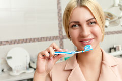 Woman with tooth brush Stock Image