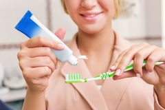 Woman with tooth brush Stock Images