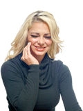 Woman with a toothache. A blonde haired woman is suffering from a toothache royalty free stock photos
