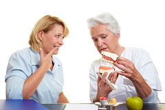 Woman with toothache at dentist Stock Photos