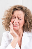Woman with toothache Stock Image