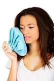 Woman with toothache and ice bag. Royalty Free Stock Photo