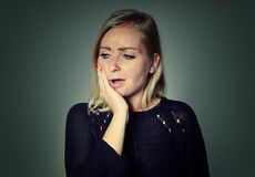 Woman with a toothache. Royalty Free Stock Photography