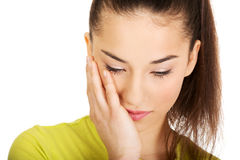 Woman with a toothache touching face. Stock Photography