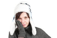 Woman with a toothache, wearing winter hat and glo Royalty Free Stock Image