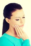 Woman with toothache. Young woman with tooth ache Stock Images