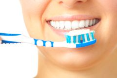 Woman with toothbrush royalty free stock image