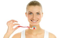 Woman with a toothbrush Stock Images