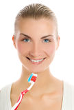 Woman with a toothbrush Royalty Free Stock Images
