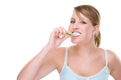 Woman with toothbrush Stock Images