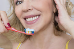 Woman and a toothbrush Royalty Free Stock Photography