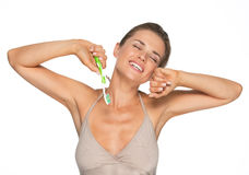Woman with toothbrush stretching after sleep Royalty Free Stock Image