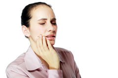 Woman with toothpain. Closeup portrait young woman with sensitive tooth ache, crown problem about to cry from pain, touching outside mouth with hand, isolated stock photography