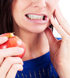 Woman with a toothpain Stock Images