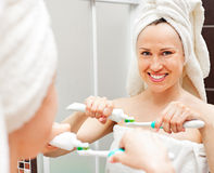 Woman with toothpaste and toothbrush Stock Images