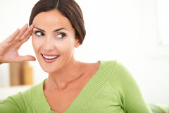 Woman with toothy smile looking away Royalty Free Stock Image