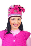 Woman with toothy smile in pink knitted cap royalty free stock images