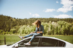 Woman on Top of Car Royalty Free Stock Photography
