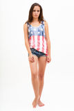 Woman in top colors of USA flag and jeans Stock Photography