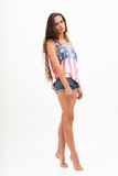 Woman in top colors of USA flag and jeans Royalty Free Stock Photography