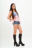 Woman in top colors of USA flag, jeans and black boots Stock Photography