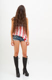 Woman in top colors of USA flag, jeans and black boots Royalty Free Stock Images