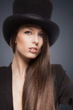 Woman in top hat Stock Images