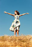 Woman on top of the hill, blue sky , summer day Stock Images