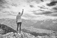 Woman on top of mountain stock photos