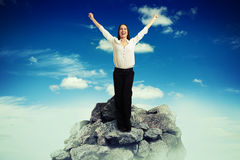Woman on top of mountain Stock Images