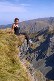 Woman on top of the mountain Royalty Free Stock Images