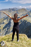 Woman on top of the mountain Stock Photos