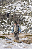 Woman in the top of a in mountain hiking. A handsome woman in a top of a in mountain hiking in winter Stock Photography