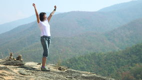 Woman on the top of the mountain_4K_1. Woman on the top of the mountain 4K video stock footage
