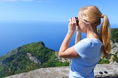 Woman at top of mountain Stock Images