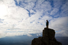 Woman on top of the mountain reaches for the sun. Woman on top of the mountain looking to the sun Stock Photos