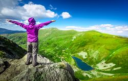 Woman on top of a mountain Royalty Free Stock Photography
