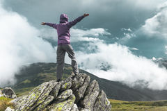 Woman on top of a mountain Stock Photography