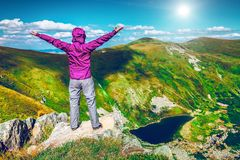 Woman on top of a mountain Royalty Free Stock Photo