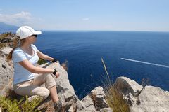 Woman at top of mountain. Looking at sea Stock Photography