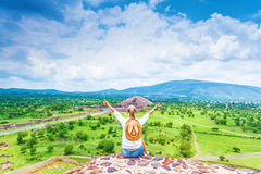 Woman on the top of mountains Stock Photo