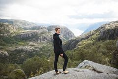 Woman on Top of Norway Mountain. Sporty pretty woman traveling in Norway Royalty Free Stock Images