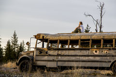 Traveler on top of the old bus Royalty Free Stock Photos