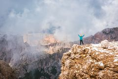 Woman on top rock Dolomites, Sella Ronda Stock Images