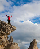 Woman on top of the rock Royalty Free Stock Image