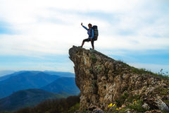 Woman on top of the rock Royalty Free Stock Photos