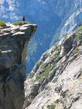 Woman on top of Taff Point. Overlook from Taft Point, Yosemite National Park Stock Photos