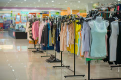 Woman top wearclothes on stands in mall Stock Photography