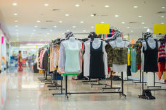 Woman top wearclothes on stands in mall Royalty Free Stock Photography
