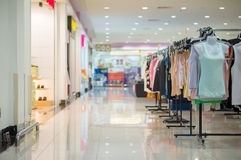Woman top wearclothes on stands in mall Royalty Free Stock Images